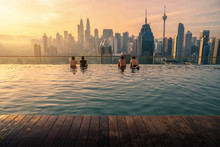Traveler Looking View Skyline Kuala Lumpur City In Swimming Pool On The Roof Top Of Hotel At Sunrise In Kuala Lumpur, Malaysia.