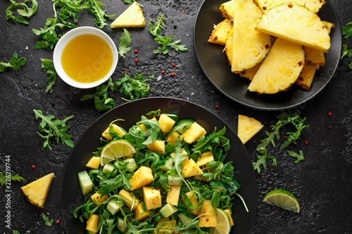 Canvas Prints Ready meals Pineapple Cucumber salad with wild green rocket, lime and olive oil. Healthy juicy food