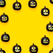 Black Halloween Pumpkins On A Bright Yellow Background