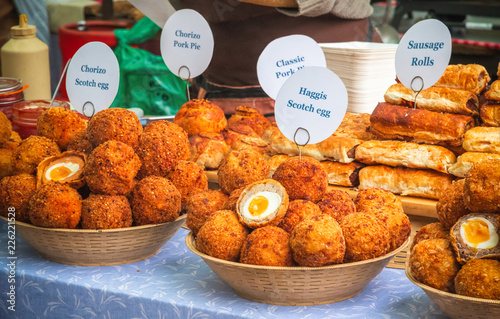 Fototapeta A variety of scotch eggs and other savoury pastry snacks on display at Broadway
