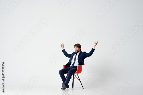 Valokuva  business man sitting on a red chair in the office