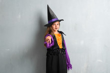 Little Girl Dressed As A Witch For Halloween Holidays  Pointing To The Front