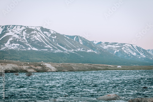Fotobehang Wit Amazing mountain landscape. mountain like flowing between high snow-capped mountains.