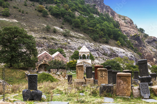 Poster Monument Medieval monastery Srbanes, VIII-XVII centuries and an ancient cemetery in the foreground. Armenia