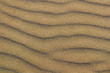 Sand wavy texture. Sandy beach for background. Top view. Spain