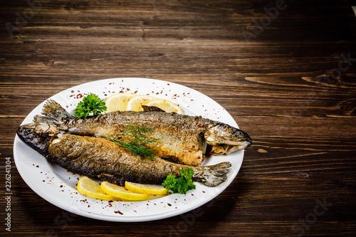 Fototapeta Fish dish - fried fish fillet on wooden table obraz