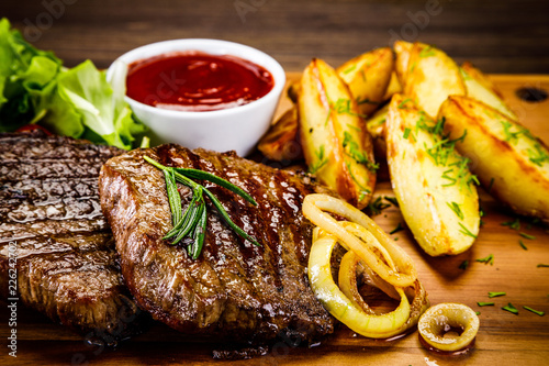 Grilled beefsteak with baked potatoes and vegetables