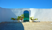 Blue Door With Cactus And The Traditional White Walls In The Town Of Ostuni Apulia Region, Italy. Panoramic Banner.