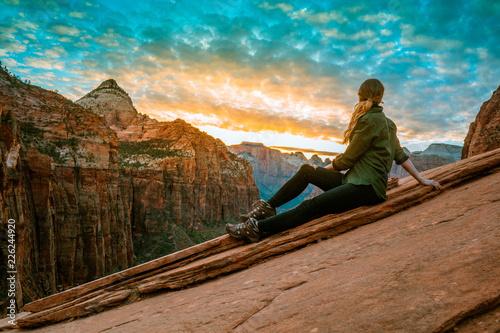 Fototapeta Blond girl with green shirt overlooking a landscape