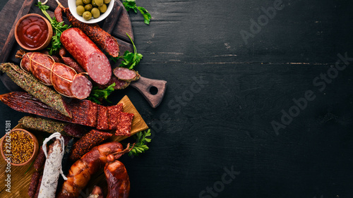 Assortment of salami and snacks Fototapeta