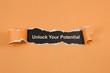 Leinwandbild Motiv unlock your potential text on paper. Word unlock your potential on torn paper. Concept Image.