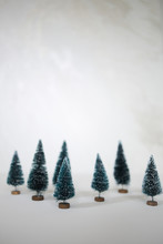 Christmas Trees With White Copy Space - Green Bottle Brush Christmas Trees With White Snow Tips Holiday Concept Background Christmas Composition
