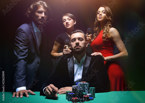фотография  Attractive young caucasian man make bet in the casino