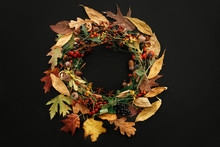 Autumn Wreath Flat Lay. Fall Leaves Circle With Berries, Nuts, Acorns, Flowers,herbs On Black Background Top View. Seasons Greetings. Space For Text. Autumn Creative Composition