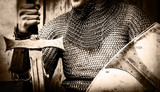 Knight man holding sword and shield. Image in black and white color style