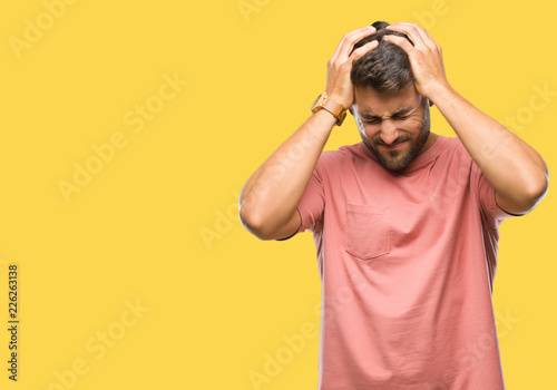 Photo  Young handsome man over isolated background suffering from headache desperate and stressed because pain and migraine