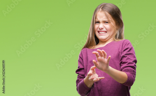 Young beautiful girl over isolated background disgusted expression, displeased and fearful doing disgust face because aversion reaction Wallpaper Mural