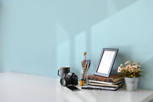 Loft Workspace With Vintage Film Camera, Books, Coffee Mug, Poster Frame And Copy Space.