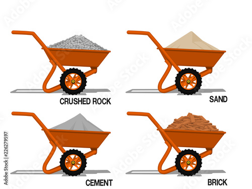 Leinwand Poster Set of construction material on barrow (sand ,cement,crushed rock, brick) on tra