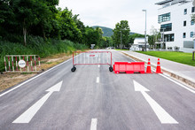 Traffic Barriers On The Road With Arrow Sign Background