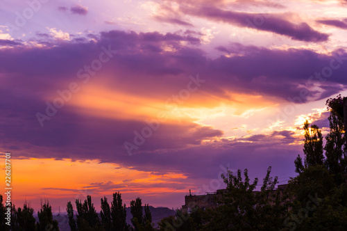 Landscape with dramatic light - beautiful golden sunset with saturated sky and clouds.