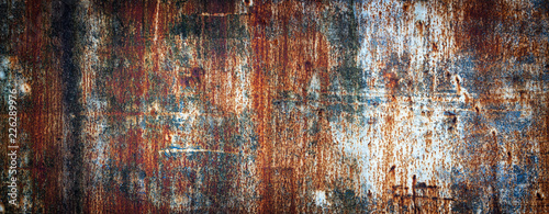 Rusty metal wall, old sheet of iron covered with rust with multi-colored paint Fotobehang