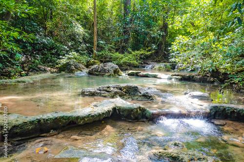Fototapeten Forest river Deep forest waterfall in erawan national park kanchanaburi ,Thailand nature travel