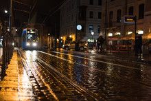 The Tram Arrives On A Rainy Night In The Tram Station In Krakow