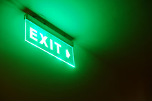 Perspective View Of Green Emergency Fire Exit Sign Hanging On The Ceiling