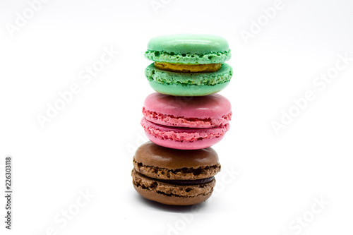 macarons stacked, sweet colorful macarons on white background