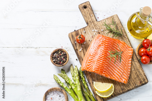 Salmon fillet with ingredients for cooking -  fresh vegetables a Canvas Print