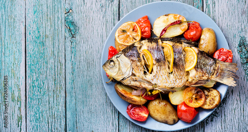 Foto op Canvas Vis Fish baked with vegetable garnish
