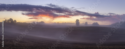 Keuken foto achterwand Lavendel beautiful, dramatic sky over an autumn field enveloped in the morning mists-Poland, Drawskie Lakeland