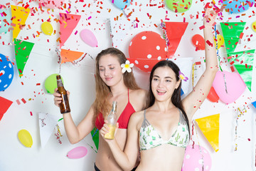 Sexy hot girl wearing bikini dancing  party event  new year or birthday.confetti happy and funny concept