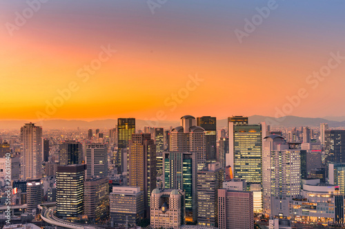 Spoed Foto op Canvas Stad gebouw Umeda city central business downtown with after sunset sky background, Japan