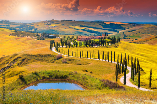 Foto  Autumn Tuscany landscape with curved road and cypress, Italy, Europe