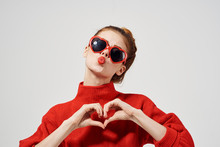 Woman In Glasses Shows Heart With Her Hands