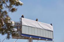Worker Prepares Billboard To I...
