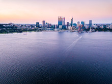 Aerial Photograph Of Perth City, Western Australia During Dusk With The Swan River In The Foreground.