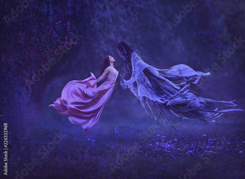 Fotografia The mysterious witch is dancing with a demon, dark forces, in the air
