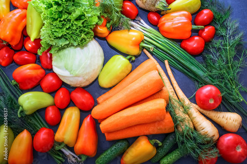 Fotobehang A rich variety of autumn colorful bright and fresh vegetables and roots.