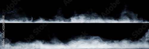 Poster Fumee Panoramic view of the abstract fog or smoke move on black background. White cloudiness, mist or smog background.