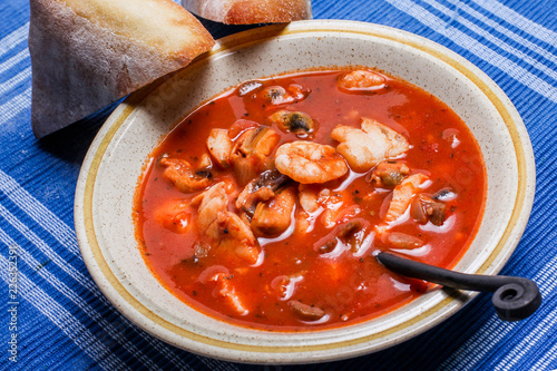 Fotografie, Obraz  Delisious fisherman stew with bread on plate
