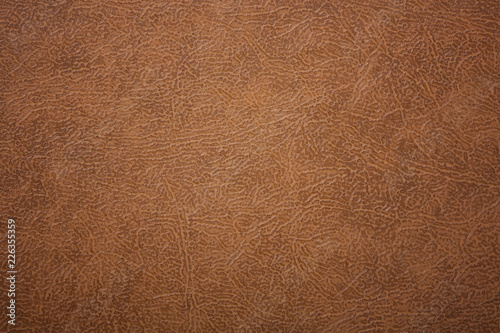 Brown or orange textured leather background. Abstract leather texture.