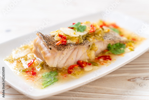 Steamed Grouper Fish Fillet with Chili Lime Sauce in lime dressing Fototapet