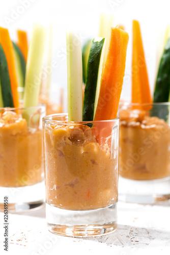 pumpkin hummus and fresh vegetables, vertical closeup