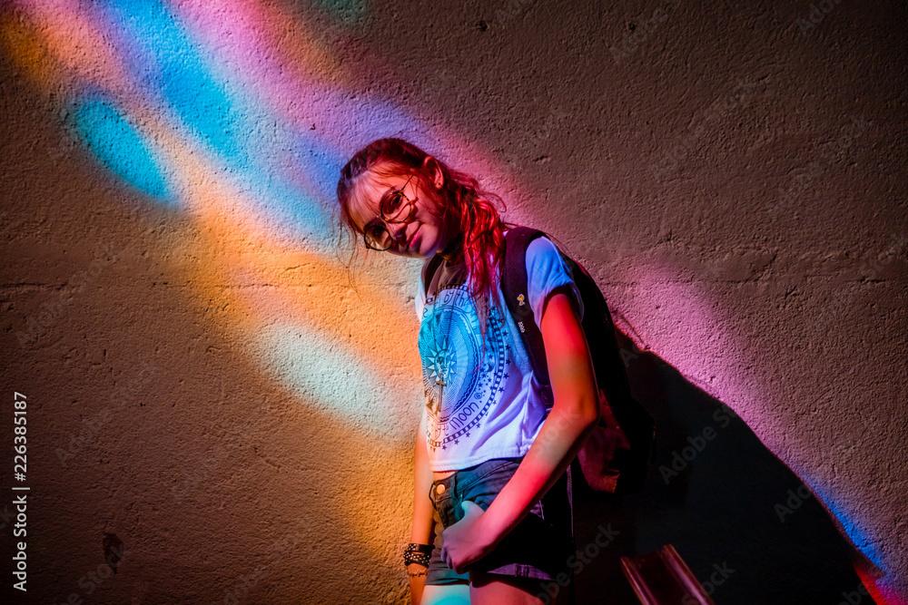Fototapety, obrazy: Jeune fille sous un vitrail dans L'église de Pontgibaud
