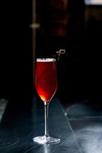 Red Cocktail Against A Black B...