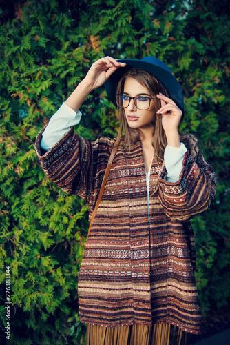 Poster Gypsy stylish lady in park