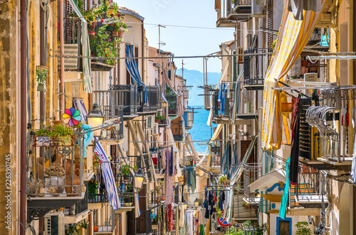 Papiers peints Palerme A cozy street in Cefalù on a sunny summer day. Sicily, southern Italy.